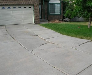 Spotting driveway damage early is key to successfully repairing it